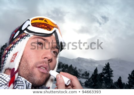 Man applying sunblock to lips Stock photo © photography33