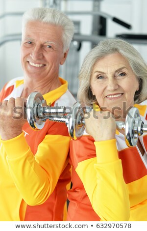 Grey-haired couple lifting weights Stock photo © photography33
