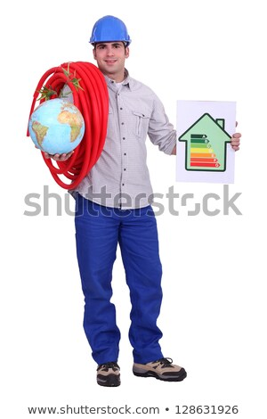Workers with globe and a symbol of power consumption Stock photo © photography33