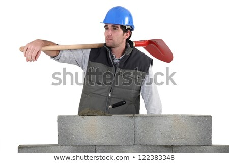 Man with spade stood by unfinished wall Stock photo © photography33