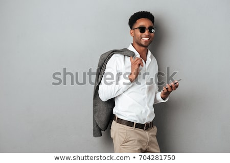 business man holding jacket over shoulder stock photo © feedough