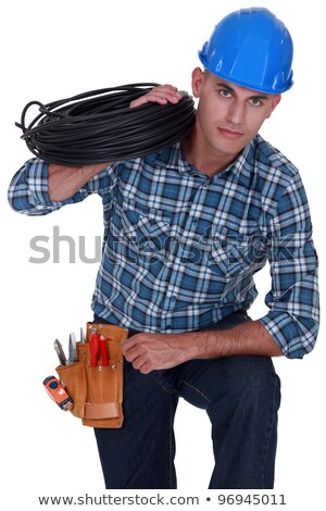 electrician holding coil of cable over shoulder stock photo © photography33