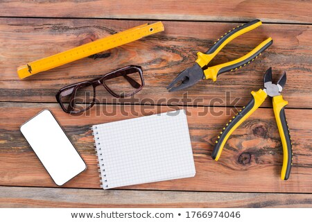 Labourer surrounded by tools and equipment Stock photo © photography33