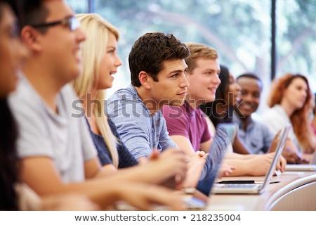 улыбаясь университета студентов группа Постоянный вместе Сток-фото © luminastock