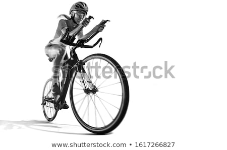 backlit silhouette of girl riding a bike black and white stock photo © lunamarina