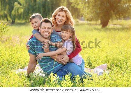 счастливая семья сидят лет луговой дочь сын Сток-фото © Kzenon