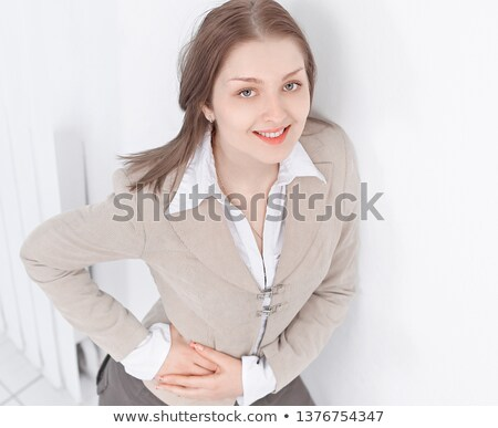 Portrait of a young caucasian businesswoman talking on the phone with aggressive air Stock photo © ambro