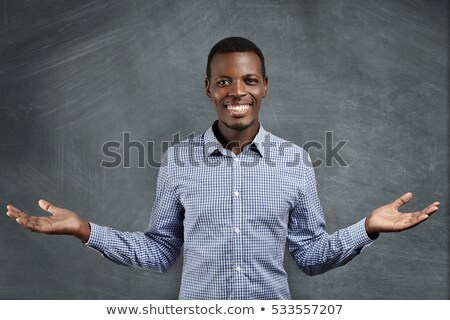 Handsome young businessman with outstretched hand Stock photo © Nejron