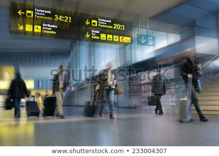 Interior of a modern terminal in international airport with esca Stock photo © anmalkov