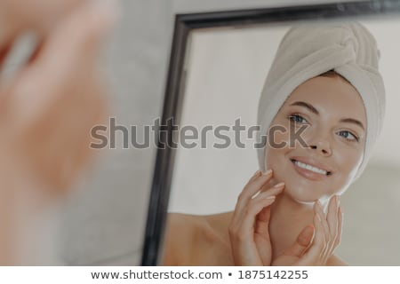 Beautiful girl wearing white towel on her head and body after sh Stock photo © Nejron