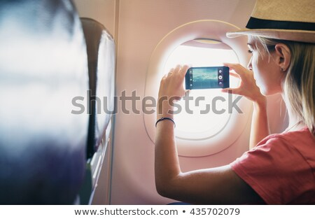 Toma fotos avión mirando fotos Foto stock © d13