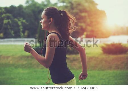 Jogging ochtend twee mooie meisjes gras Stockfoto © BrunoWeltmann