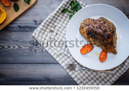 Stock photo: Plate of Grilled Steak and Garlic with Red Napkin