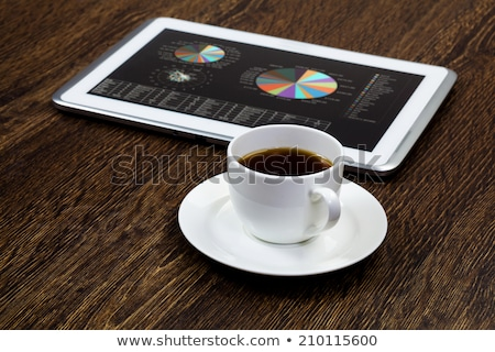 tablet touch computer gadget on wooden table graph stock photo © michaklootwijk