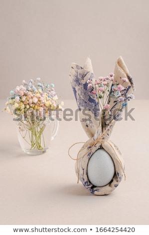Easter eggs on textile draped background Stock photo © dariazu