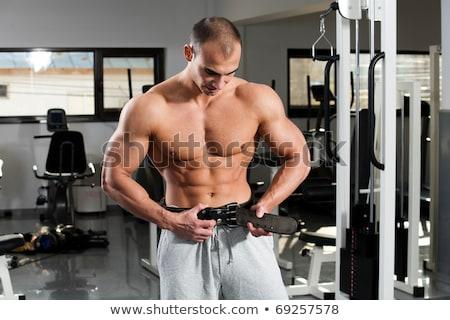 Vücut geliştirmeci vücut geliştirme kemer portre adam Stok fotoğraf © deandrobot