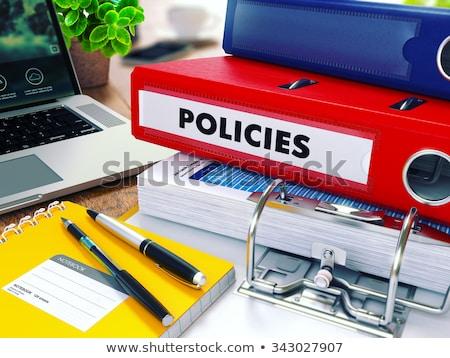 Policies on Red Ring Binder. Blurred, Toned Image. Stock photo © tashatuvango