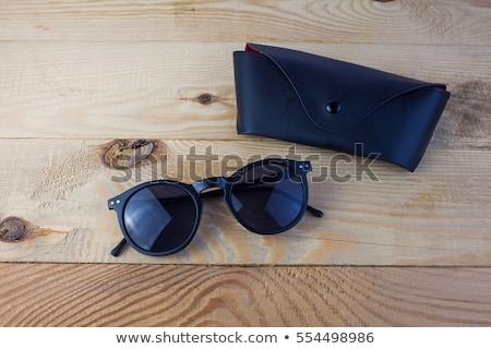 Marrom couro caso óculos de sol branco Foto stock © RuslanOmega