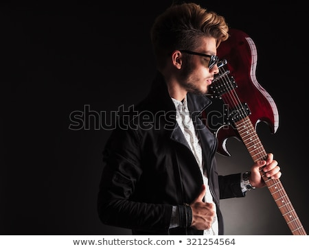 side view of a dramatic man in leather jacket and sunglasses stock photo © feedough