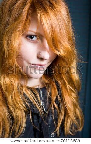 Flirty, moody portrait of a beautiful young redhead girl. Stock photo © lithian