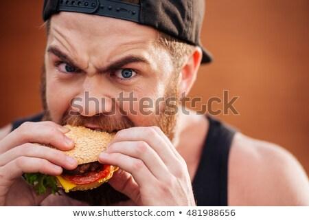 adam · yeme · Burger · akşam · yemeği · dişler · yağ - stok fotoğraf © deandrobot