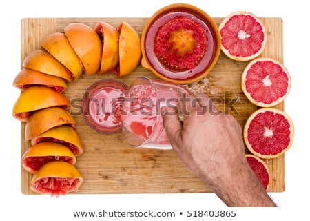 Man pouring freshly squeezed ruby grapefruit juice Stock photo © ozgur