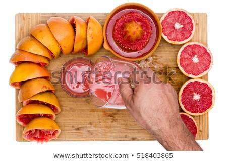 Man pouring freshly squeezed ruby grapefruit juice Stock photo © ozgur