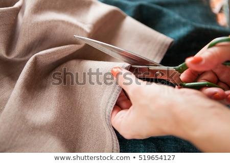 Tailor. Hands notch tailor tailor's scissors cloth. Close Up.   Stock photo © Yatsenko