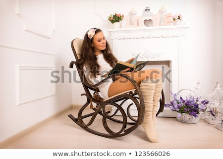 Vertical image of mystery woman with basket on head Stock photo © deandrobot