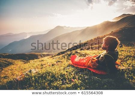 man sleeping in sleeping bag in the mountains stock photo © rastudio