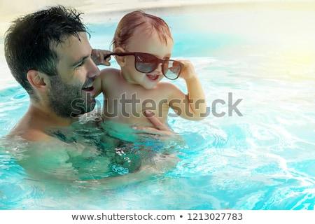 boldog · apa · fia · úszómedence · jókedv · víz · mosoly - stock fotó © dotshock