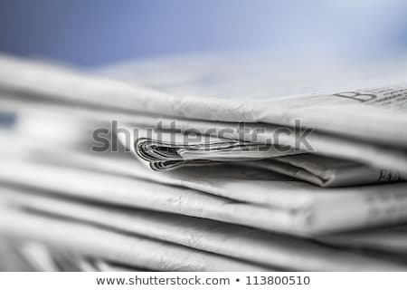 Man reading newspaper with the headline Research Stock photo © Zerbor
