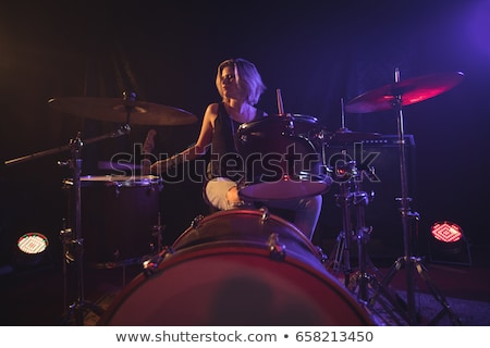 happy drummer performing on stage at nightclub stock photo © wavebreak_media
