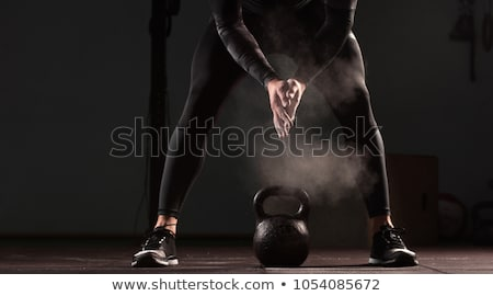 shirtless man lifting heavy kettlebells stock photo © wavebreak_media