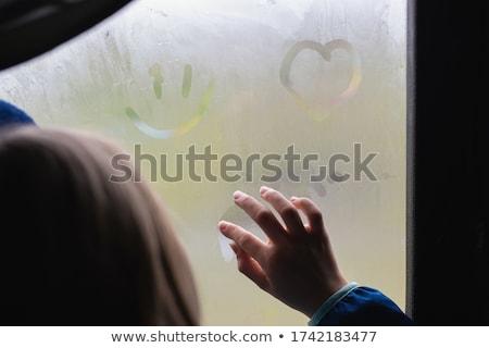 girl drawing heart sign on mirror Stock photo © LightFieldStudios