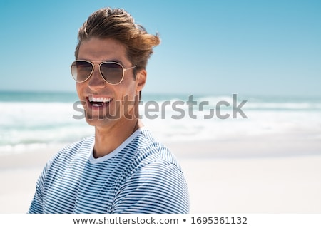 man in sunglasses with arms crossed Stock photo © LightFieldStudios