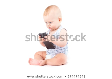 cute happy little boy in speckled shirt with cellphone stock photo © traimak