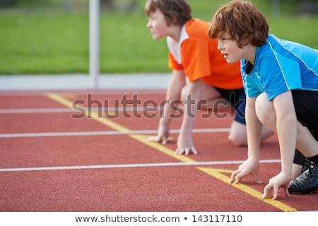 Erkek yarış pisti başlatmak pozisyon gölge koşucu Stok fotoğraf © IS2