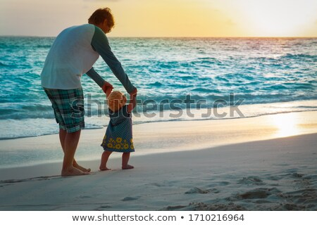 baby making first steps with father help stock photo © dolgachov
