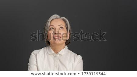 Smiling woman looking upward Stock photo © wavebreak_media