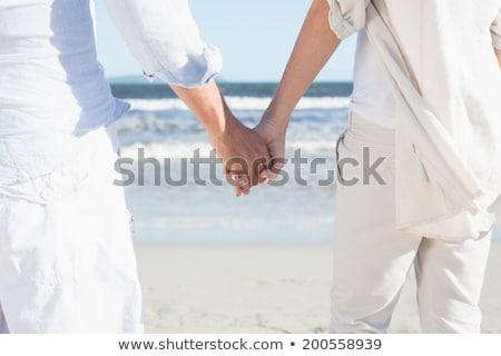 Középső rész pár kéz a kézben tengerpart szeretet férfi Stock fotó © wavebreak_media