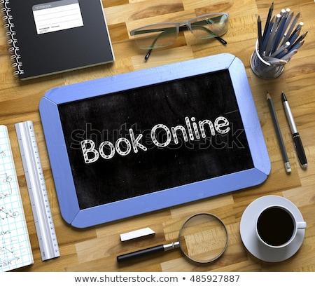 book now   text on small chalkboard 3d stock photo © tashatuvango