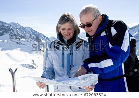 Couple reading piste map Stock photo © IS2