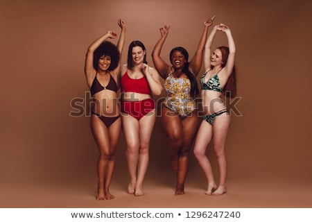 Four excited young women in swimwear Stock photo © deandrobot