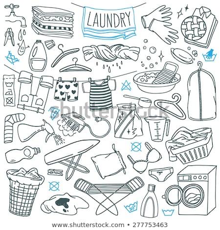 Hanger with towel hand drawn outline doodle icon. Stock photo © RAStudio