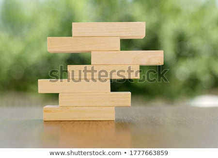 Person Stepping Finger On Wooden Blocks Stock photo © AndreyPopov