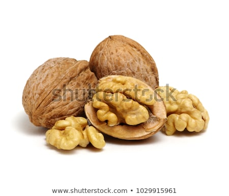 Close-up of peeled raw walnuts as a natural background. Vegetable protein for vegans. Flat lay Stock photo © artjazz