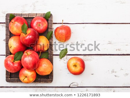 glass of fresh organic apple juice red apples in box on wooden background stock photo © denismart