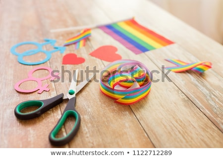 scissors and gay party props on wooden table Stock photo © dolgachov