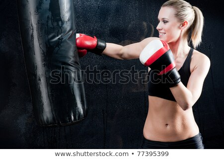 Blond boxing woman in black punching bag Stock photo © CandyboxPhoto